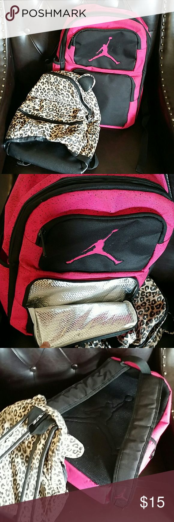 Back to school back packs The smaller back pack is from target and is big enough for a preschool kid. It was lightly used. The pink and black jordan bag is very large, has room for all the books with space to spare. It also has a cooler in front for lunches and was never used before. 15 dollars for both. 10 for the pink and black one or 5 for the leopard one. Prices are firm. Bags Backpacks