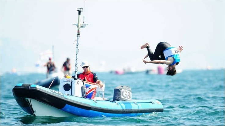 Great Britain sailor Luke Patience performs a celebratory somersault after winning a silver medal with team-mate Stuart Bithell in the men's 470 class