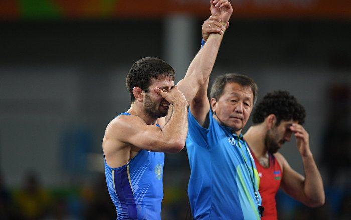 Russian freestyle wrestler Soslan Ramonov won gold medal beating Azerbaijan's…