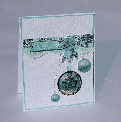 Simple Christmas shaker card with Kaisercraft's Silver Bells Collection. Made by Kirsten Hyde