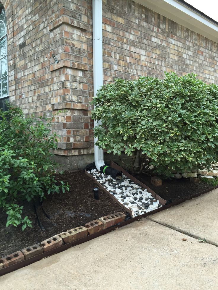 Dry creek bed for gutter drainage
