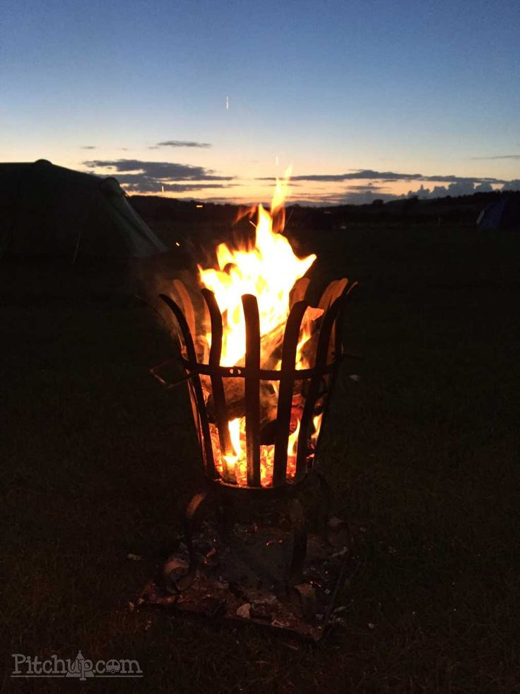 Nothing beats a fire basket. Mains Farm Camping and Caravan Site, Penrith, Cumbria - Pitchup.com