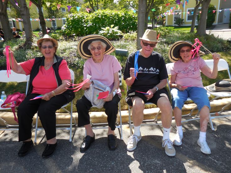 Residents at our Huntington Terrace community having a blast rooting for their favorite horse to win at their Derby Day Race!