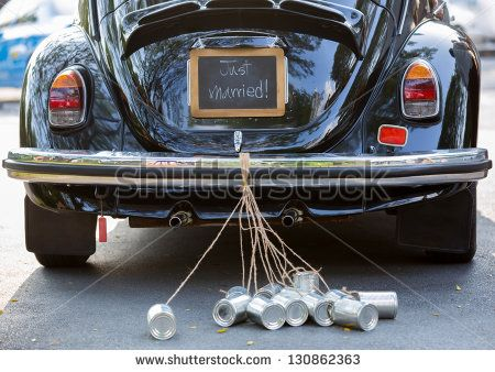 Vintage wedding car with just married sign and cans attached - stock photo