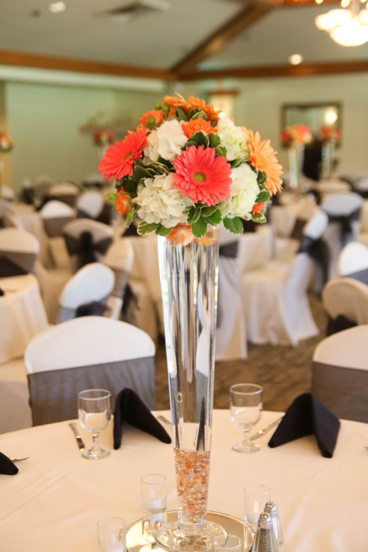 coral gerbera daisies  coral peach and white flowers coral wedding #gerberadaisy #daisy #coral #orange #peach #white #hydrangea #roses #rose #arrangement # centerpiece #wedding #flowers