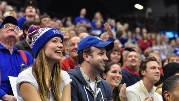 Olivia Wilde and Jason Sudeikis at a KU game
