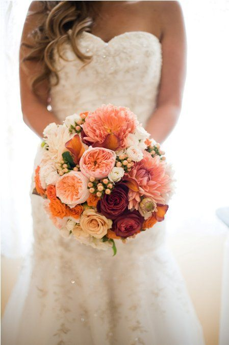 One of our favorite fall bouquets: roses, ranunculus, peonies and more all in oranges, peach and maroon!
