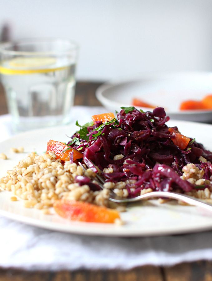 Blood Orange Braised Cabbage on Barley  - 1 cup / 200g lightly pearled or hulled barley  2 – 2 ½ cups water or broth  ¼ tsp. sea salt    1 small head red cabbage (approx. 500g /1 lb.)  2 medium onions  4 cloves garlic  knob of coconut oil or ghee  ½ tsp. sea salt  5 bay leaves  1 Tbsp. fennel seeds  ½ Tbsp mustard seeds  2 whole star anise  black pepper  1 cup blood orange juice (from 3-4 oranges, any orange would be fine)  2 Tbsp. apple cider vinegar  1 blood orange, segment