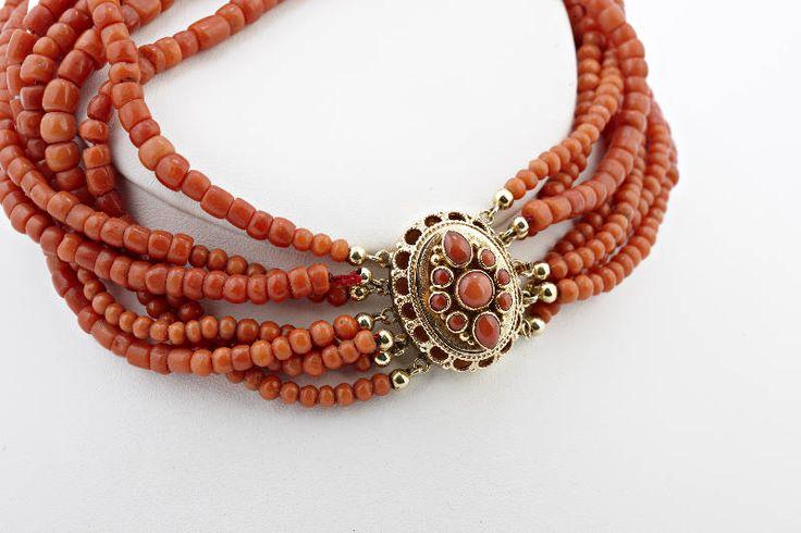 coral necklase worn with Dutch folkdresses