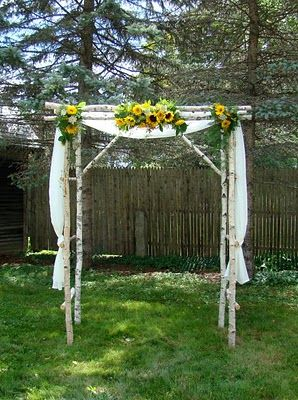 Sunflowers chuppah and sunflower weddings on pinterest for Decorating a trellis for a wedding