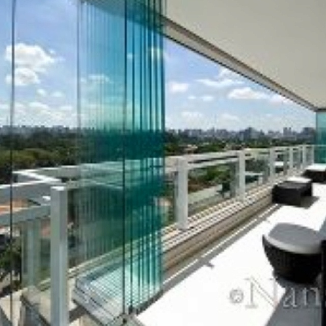 Wanna do a sliding glass wall system and remove old picture window on  balcony.