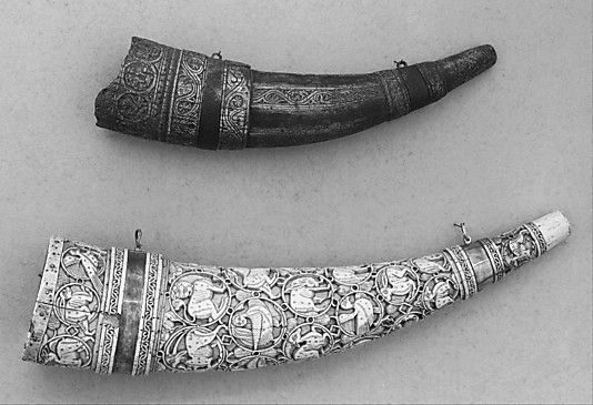 """Oliphant (Hunting Horn) Date: ca. 1200 Culture: possibly southern Italian Medium: Ivory, copper alloy Dimensions: Length, 16 in. (40.64 cm) Greatest width, 3 5/8 in. (9.19 cm) Classification: Firearms  """"Hunting horns of this type, carved from elephant ivory (hence the name oliphant), were made by Muslim craftsmen in southern Italy and Sicily for export throughout Europe."""""""