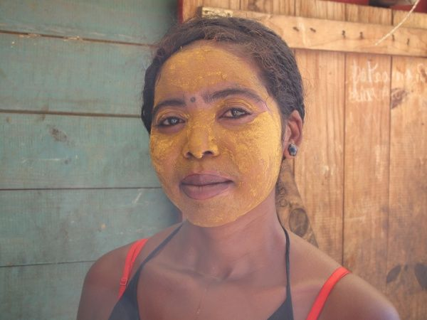 Malagasy woman wearing traditional make up http://madacamp.com/Tulear