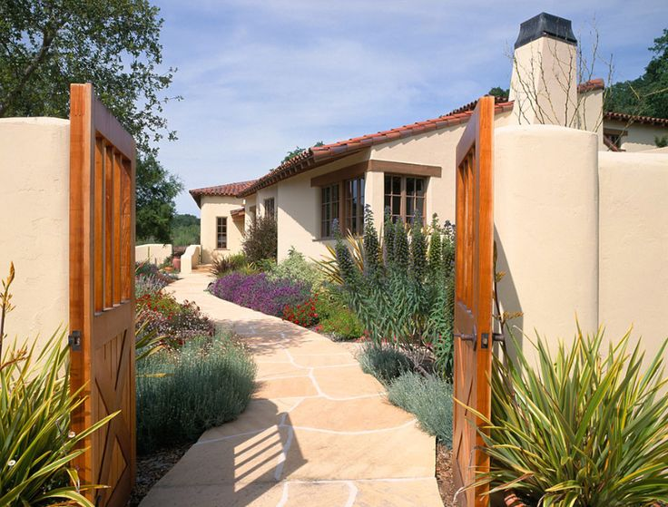 Stucco house flagstone walkway drought tolerant plants for Stucco garden wall designs