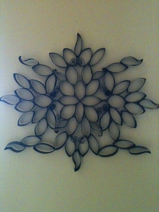 The secret to this intricate wall art? It's made from toilet paper rolls!