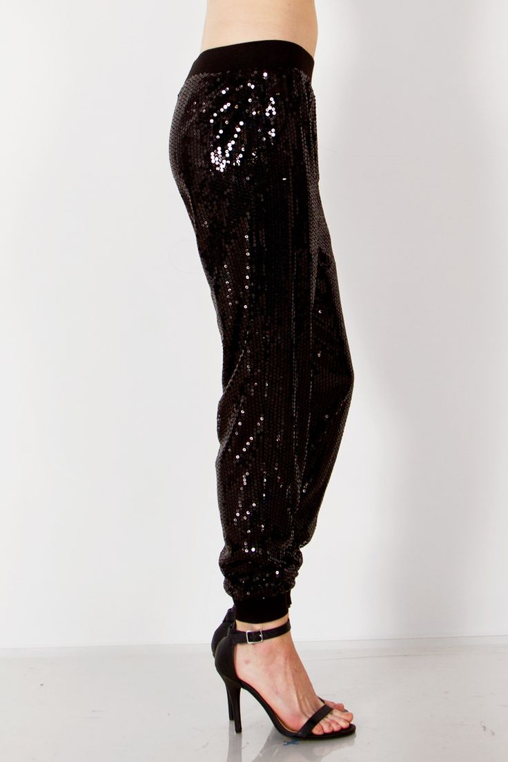 Perfect party pants. Black sequin jogger pants. Self: 100% Polyester. Contrast: 98% Polyester, 2% Spandex. Lining: 100% Polyester