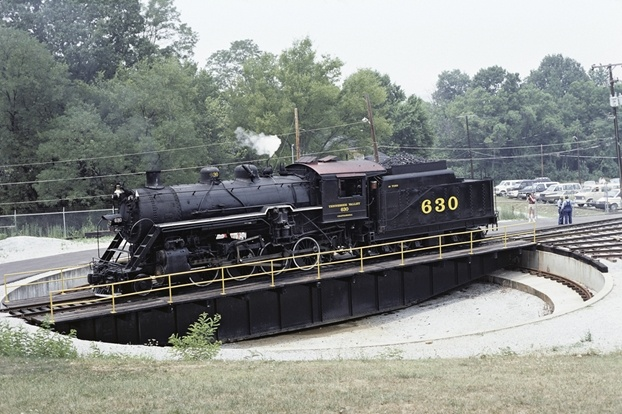 Southern Railway 2-8-0 No. 630, an Alco-Richmond product of 1904, rides the former Central of Georgia turntable at Tennessee Valley Railroad Museum on July 9, 1988. The engine is nearing completion of a rebuild in 2010