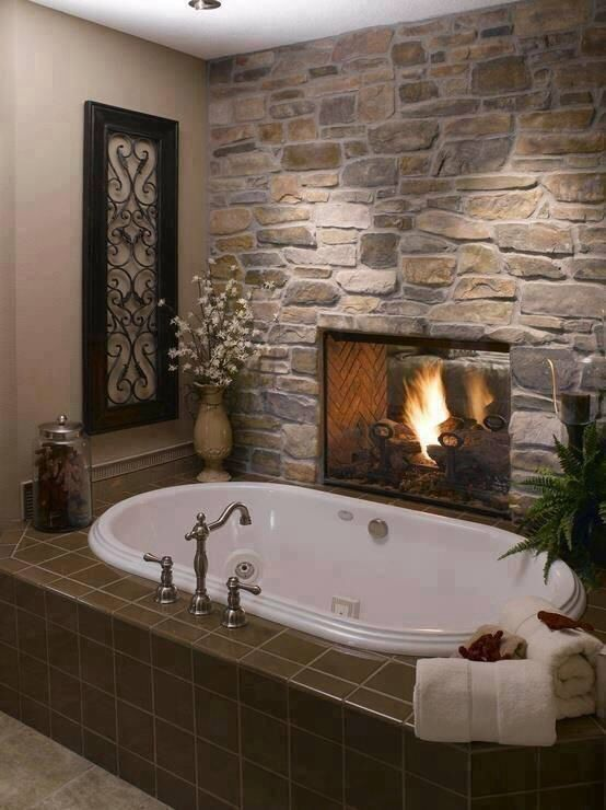 Tub next to the fireplace, totally awesome!