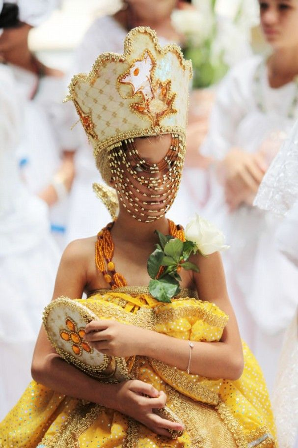 A girl dressed in ceremonial Oxun clothing takes part in a washing ceremony during an event celebrating National Black Consciousness Day in Brasilia, Brazil