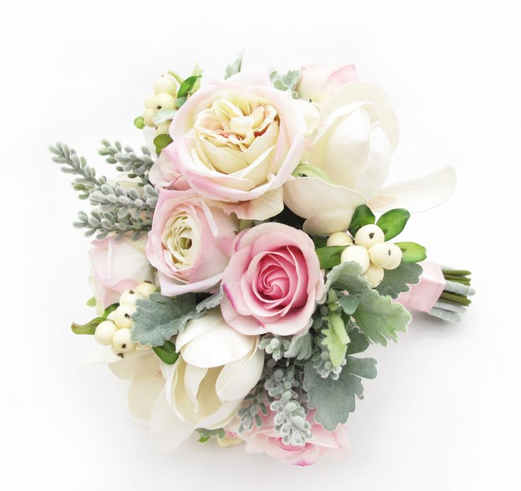 Garden-style bouquet of roses, magnolias, snowberries and foliage by https://www.loveflowers.com.au