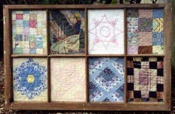 old window frame with vintage quilt pieces....gotta love it!