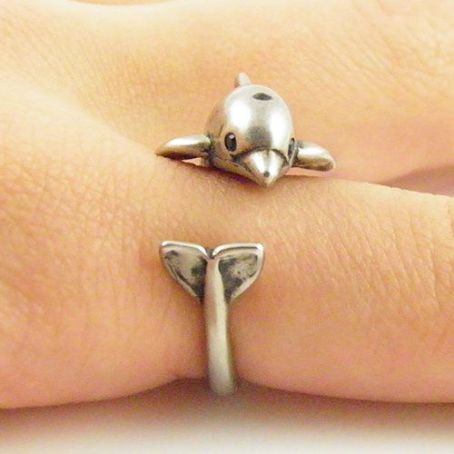 Can you say Flipper!!! Awe he's so cute!!! Like he jumped out of the water on to your finger. This gold dolphin ring is slightly adjustable with a gentle squeeze. It fits a size 5-9. He is sweet with Swarovski Crystal eyes, blow hole and dorsal fin as this little guy wraps around your finger, the...