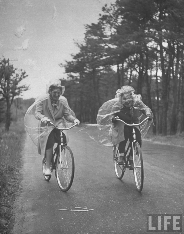 Summer visitors bicycling in the rain. Cape Cod, 1940. By Alfred Eisenstaedt