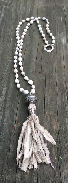 Beaded Necklace with toggle clasp & African seed beads with silk tassel
