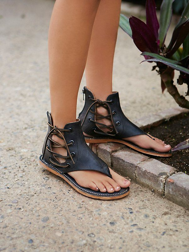 Baske Sandal   Leather sandal with lovely lace-up details on the sides and subtle cutout at the heel. Exposed back zipper closure for an easy on off.