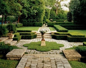 rustic stone paving, clipped hedges, sunken garden