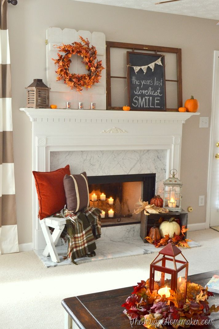 Fall mantel lit by candlelight:
