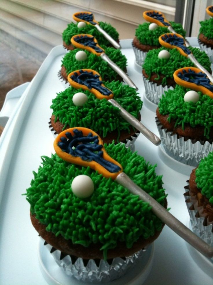 Lacrosse Cupcakes My first attempt at making Lacrosse Cupcakes... the sticks and balls are all made of fondant and the net I piped with...