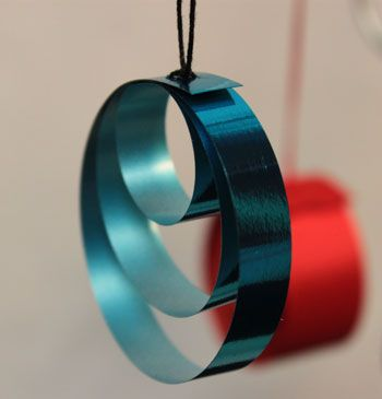 Some ribbon and some yarn quickly turn into this simple yet pretty ribbon circles ornament.