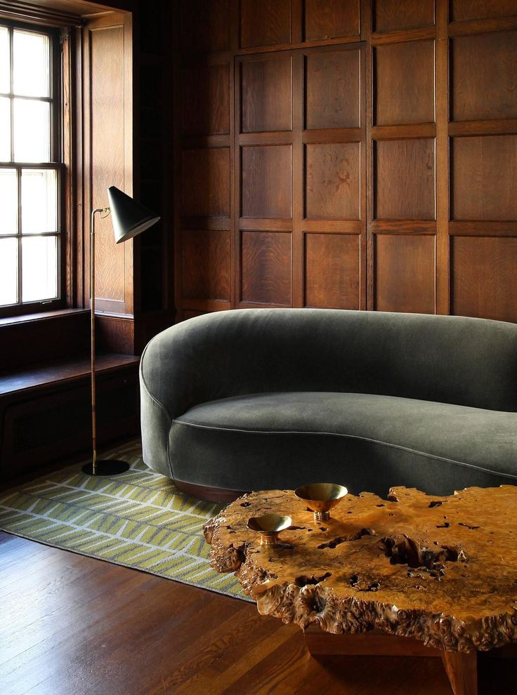 An outstanding mix of American and Nordic MidCentury modern design: Ingrid Dessau´s reversible rug (1950s), Vladimir Kagan sofa (1970s), George Nakashima burl wood coffee table (1970s) and brass bowls & floor lamp by Paavo Tynell (1940s). / 1stDibs