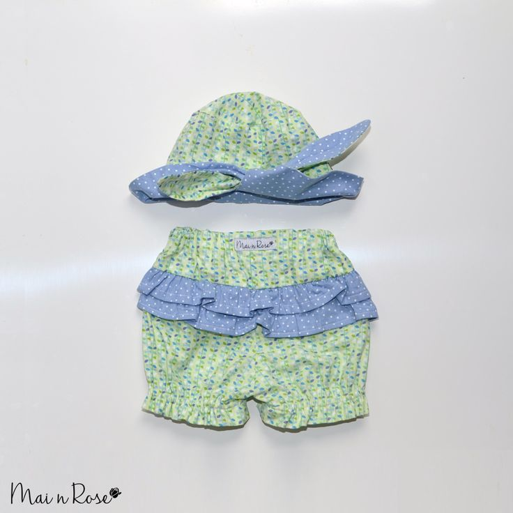 "Our ""Vines"" hat and bloomer set is a must have for this summer! Made from 100% cotton, the hat keeps your little one protected from the sun while the bloomers cover up that nappy with adorable ruffles, so your bub can get around in style.Reversible hat - can be worn Vines or Blue and White polkadots[Shipping includes tracking]"