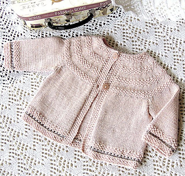 Ravelry: Baby jacket with round yoke and Moss stitch trim P033 pattern by OGE Knitwear Designs