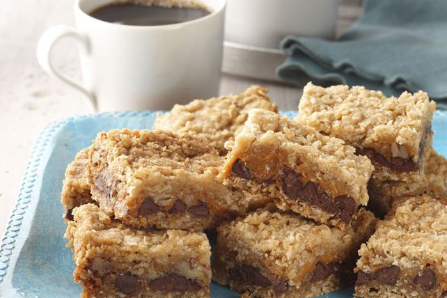 Chocolate chips, chopped pecans and creamy caramel come together in these chewy oatmeal bars.  This big batch of baked bars is perfect for bake sales, family get-togethers or potlucks.