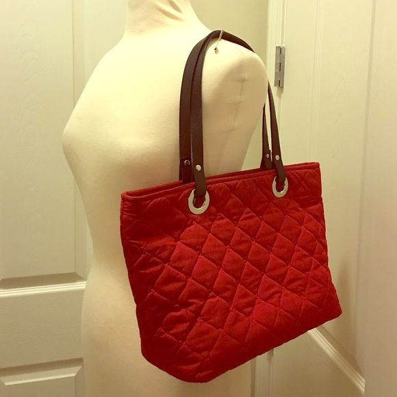 Banana Republic Quilted Tote NEW LISTING! Beautiful red quilted Banana Republic tote with black leather trim. Good condition! Banana Republic Bags Totes