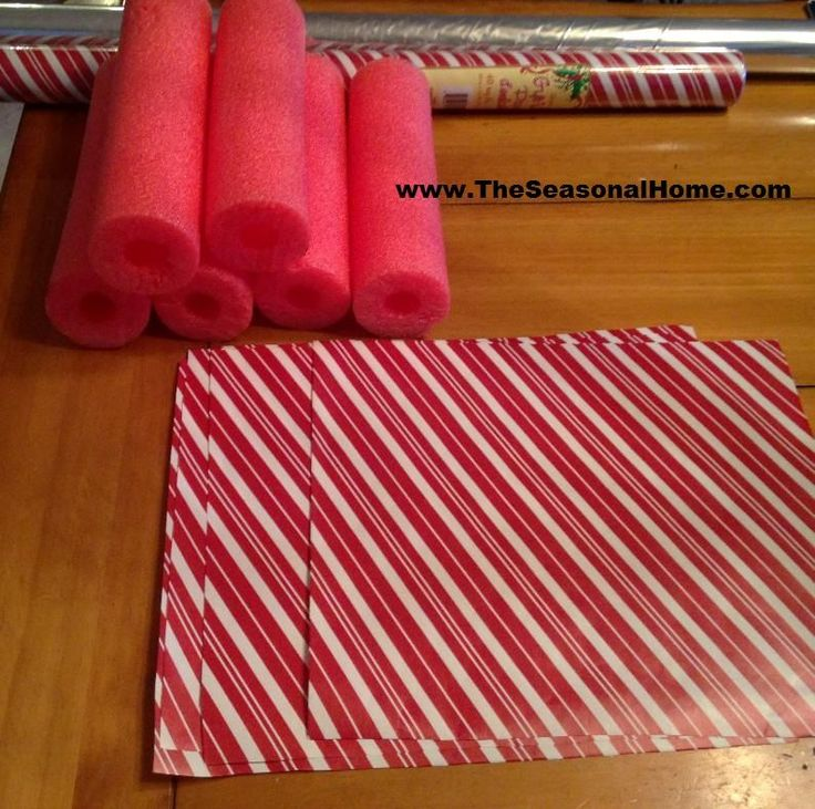 candy decorations -love the idea of the light weight pool noodles, would be so much easier to secure to the wall