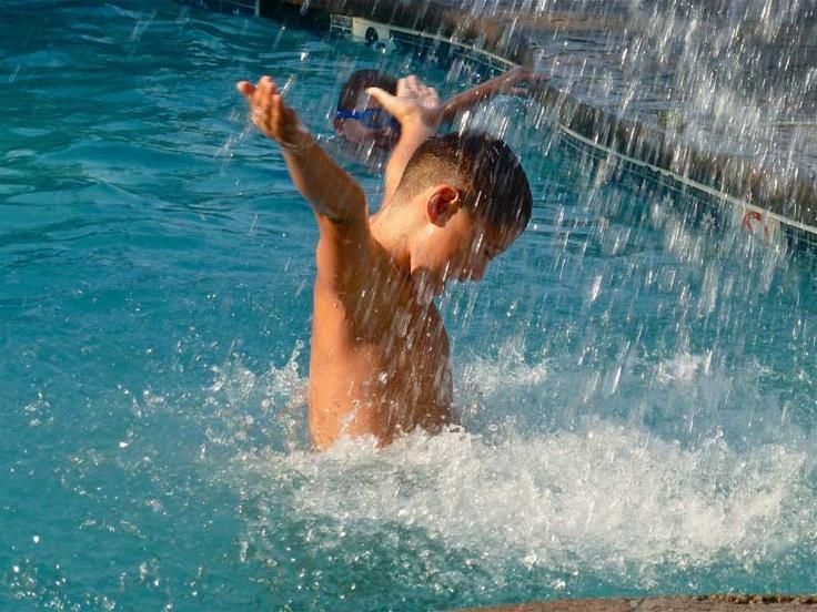 Eldy's grandson enjoying a waterfall in a resort pool in South Carolina.