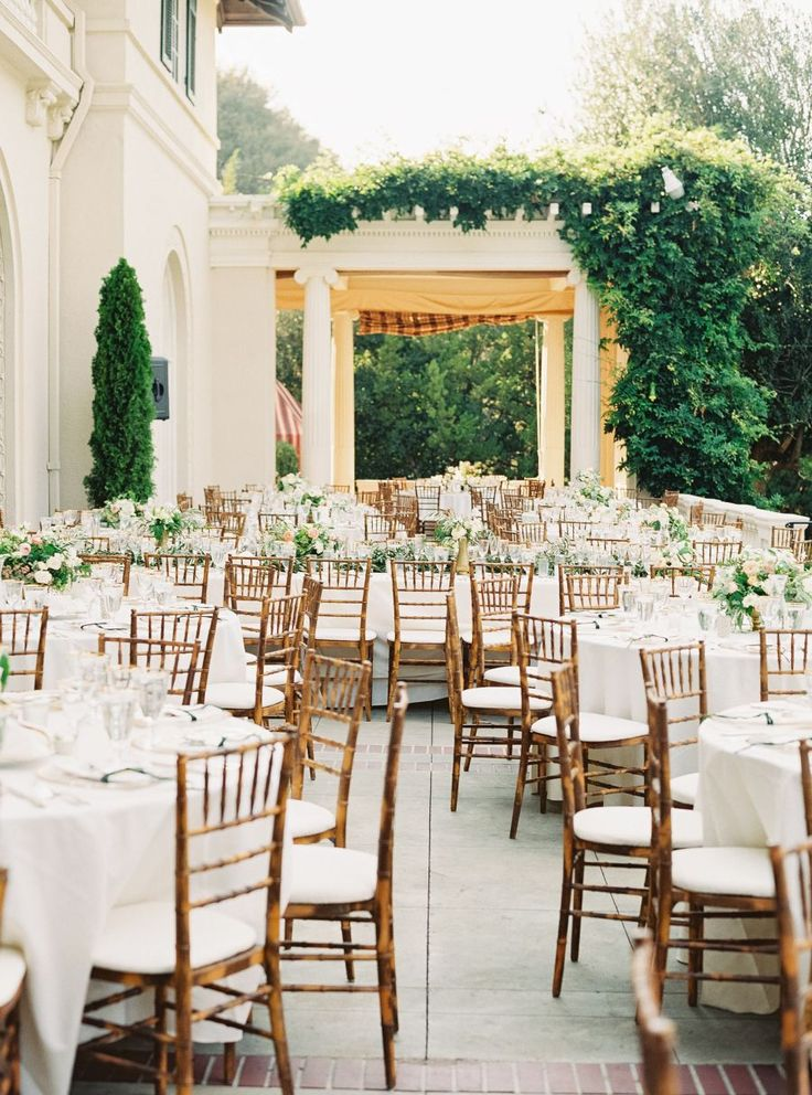 classic chiavari chairs paired with white table cloths and simple white and greenery for an outdoor reception | white table linens | classic elegant | English Garden Style Wedding in California