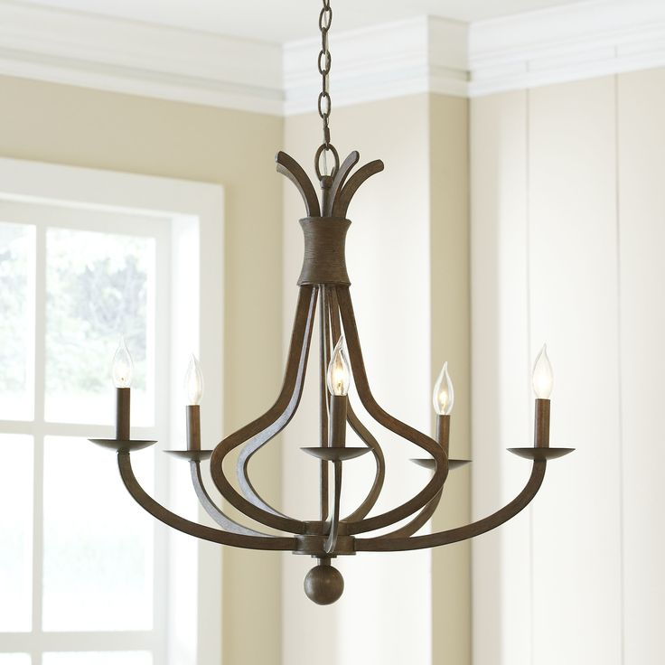 Egleston Chandelier | Featuring five fixtures and an aged, metallic finish, this chandelier offers a rustic-chateau feel for your space.