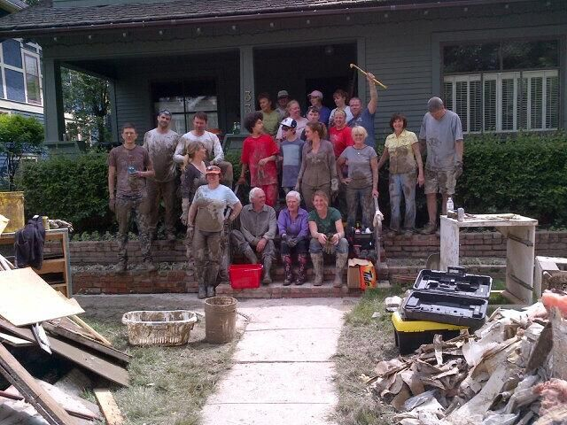 Despite the mess still big smiles and lots of laughs!#yycflood pic.twitter.com/8bewjYUSvD