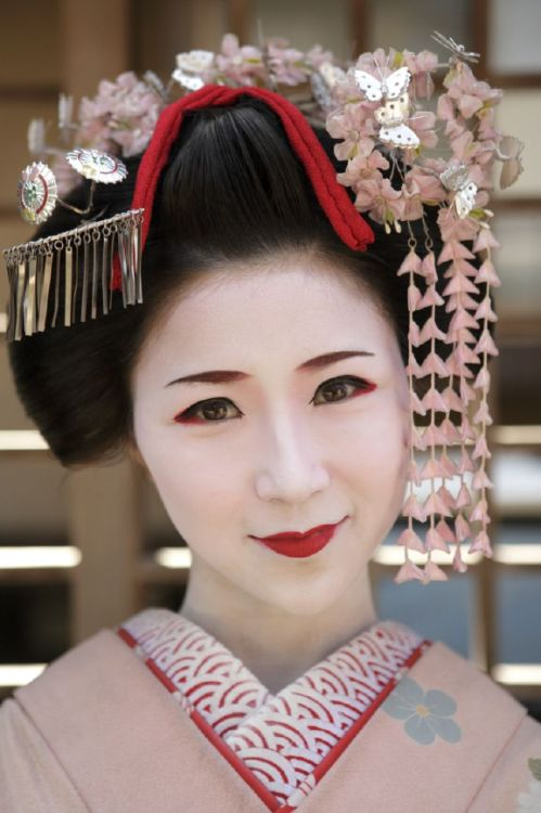 A Japanese girl dressed as a 'maiko' (a trainee geisha) in Kyoto, Japan. During her training, a maiko learns skills such as traditional dancing, how to speak the Kyoto dialect and how to play the shamisen, a three-stringed instrument // photo by Lottie Davies in our August '10 feature 'The Perfect Trip: Japan' http://www.lonelyplanet.com/magazine/