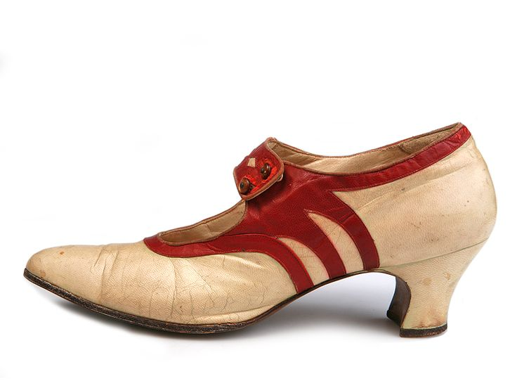 1922-23 lady's white kidskin shoes with red skin applique along the edge and on the strap.