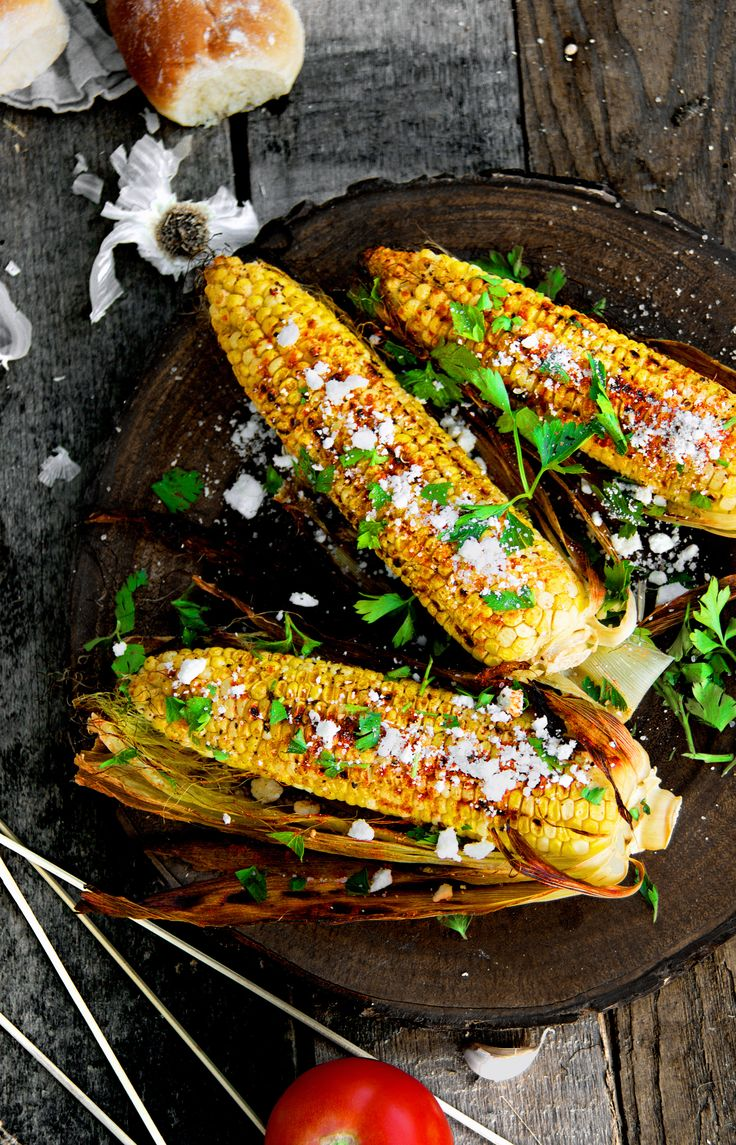 """Grilled Chili-Spice Corn on the Cob with Cilantro-Lime Butter and Queso Fresco 