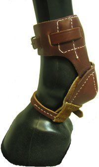 Leather Skid Boot . $22.99. Latigo Leather Skid Boot! Leather Skid Boots made of latigo leather with suede lined heel cup complete with a hole for dirt elimination. Durable hardware and strapping stabilize the heel making this boot popular among Reiners and Ropers. Priced per pair.