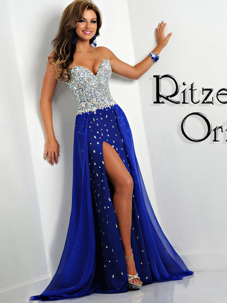 This dazzling Ritzee Originals pageant dress will make you sparkle all night long. This jersey and chiffon Ritzee Originals 2448 pageant dress has a sweetheart neckline, heavily beaded bodice decorated with sparkly jewels, and a slim floor length skirt with a sexy high slit and scattered beading. A chiffon overlay completes this Ritzee Originals pageant dress. If you are gorgeous and you know it, slip into this fabulous Ritzee Originals pageant dress.