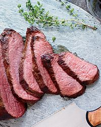 Seared Sous Vide-Style Tri-Tip  - teal a chef technique without the fancy equipment: This is Nick Kokonas' trick for cooking sous vide at home. The tri-tip roast cooks slowly and gently in a sealed bag submerged in barely hot water, resulting in luscious, juicy beef. It's then grilled until nicely charred and rested for 10 minutes before slicing and serving.Recipe on Food & Wine