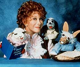 Shari Lewis (January 17, 1933 – August 2, 1998) --65 years old--was an American ventriloquist, puppeteer, and children's television show host, most popular during the 1960s and 1990s. She was best known as the original puppeteer of Lamb Chop, first appearing on Hi Mom, a local morning show that aired on WRCA-TV (now WNBC-TV) in New York City.